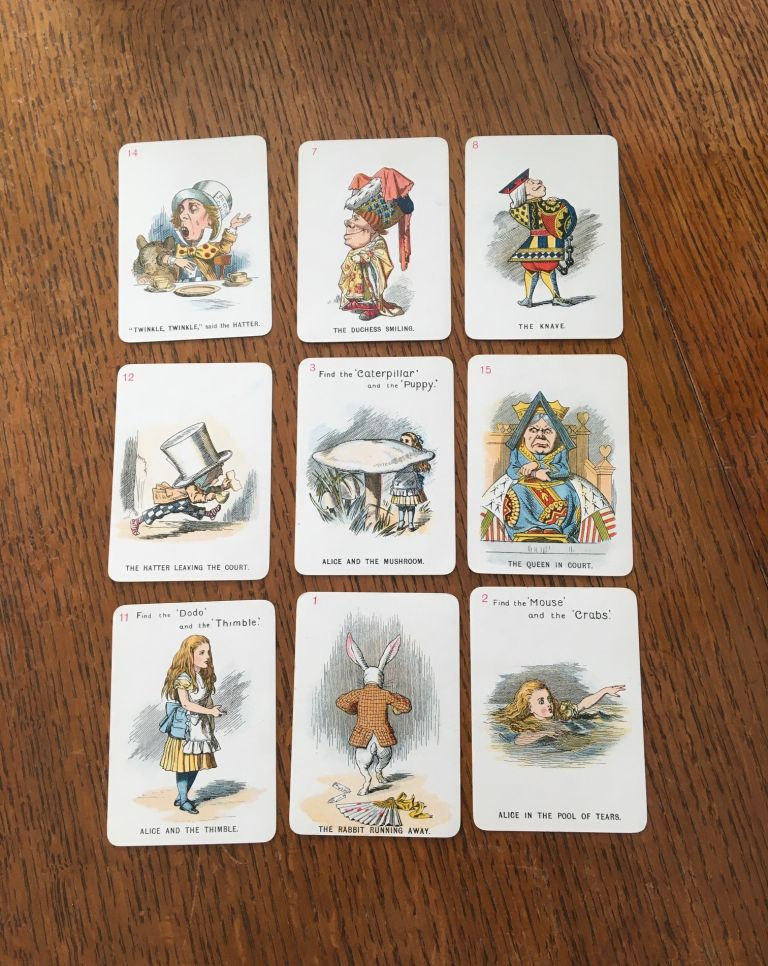 THE NEW AND DIVERTING GAME OF ALICE IN WONDERLAND. Consisting of forty-eight pictorial cards, Adapted, drawn in fac-simile, and elaborately rendered in colours, from Sir John Tenniel's original designs by Miss E. Gertrude Thomson. CARROLL. LEWIS.