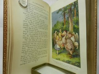 ALICE'S ADVENTURES IN WONDERLAND AND THROUGH THE LOOKING GLASS, AND WHAT ALICE FOUND THERE. With Ninety-Two illustrations by John Tenniel, Including Eight in colour.