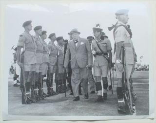 ORIGINAL PHOTOGRAPH. Prime Minister Winston Churchill inspecting the Guard of Honour of the Royal Welsh Fusliers at Kindley Airport, Hamilton, Bermuda, December 2nd, 1953. Anthony Eden, then British Foreign Secretary, follows behind. Churchill was i. CHURCHILL. WINSTON. SPENCER., Jurkoski. Frank. Photographer.